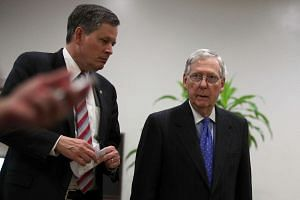 US Senate Majority Leader Sen. Mitch McConnell (right) leaves with Sen. Steve Daines (left) after a closed briefing on the airstrikes against Syria by Chairman of the Joint Chiefs Gen. Joe Dunford on April 7, 2017 at the Capitol in Washington, DC.