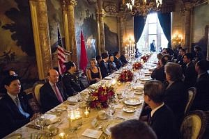 Members of the Chinese and US delegations at a dinner for Mr Xi Jinping, hosted by Mr Donald Trump, in a private room at the US President's Mar-a-Lago resort in Palm Beach, Florida, on Thursday.