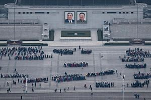 North Koreans preparing for an upcoming parade at Kim Il Sung Square, named after the country's founder, on Thursday. Pyongyang this week fired another missile and is said to be gearing up for a showcase of its prowess to mark the 105th anniversary o
