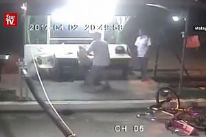 CCTV video of the incident shows the suspect catching the dog by its scruff and bashing it. Halfway through the video, the man even uses a motorcycle helmet to pummel the animal.
