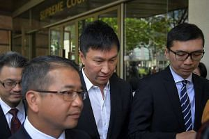 """Kong Hee leaving the court. In meting out the harshest sentence among the six church leaders to Kong, the judges agreed he was the """"ultimate leader"""" of the five others."""