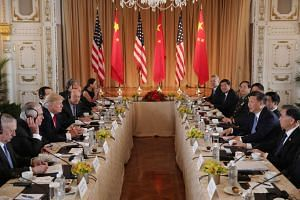 US President Donald Trump (third, left) holding a bilateral meeting with China's President Xi Jinping (second, right) at Trump's Mar-a-Lago estate in Palm Beach, Florida, US, on April 7, 2017.