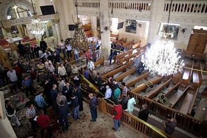 Security personnel investigate the scene of a bomb explosion inside Mar Girgis church in Tanta, Egypt, on April 9, 2017.