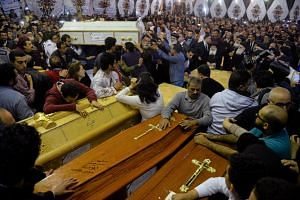 Relatives of victims reacting to coffins arriving at the Coptic church that was bombed on Sunday, April 9, 2017, in Tanta, Egypt.