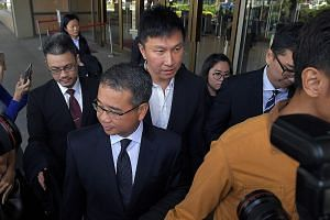 City Harvest Church (CHC) founder and senior pastor Kong Hee (centre) leaving the Supreme Court last Friday with his lawyer, Mr Edwin Tong, in front of him. Kong has said through his lawyer that he will study the filing by the Attorney-General's Cham