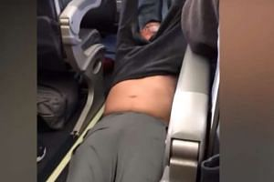 A screenshot from online footage of the man being dragged from the plane.