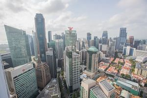 Commercial buildings stand in the Central Business District of Singapore, on Tuesday, Feb 14, 2017.
