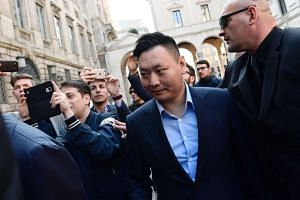 Han Li, the representant of Chinese consortium Sino-Europe Sports, arrives to finalise the deal on April 13, 2017.