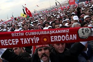 "Supporters of Mr Recep Tayyip Erdogan at a ""Vote Yes"" rally in Istanbul, Turkey, last Saturday. Opponents worry that the new system, if voted in, will move the presidency towards one-man rule."
