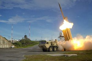 Terminal High Altitude Area Defense (Thaad) interceptor is launched during a successful intercept test, in this undated handout photo provided by the US Department of Defense, Missile Defense Agency.