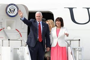 US Vice-President Mike Pence waves upon his arrival at the Osan Air Base in Pyeongtaek, South Korea, on April 16, 2017.