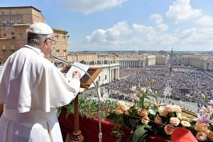 Pope Francis delivers his Urbi et Orbi message from the balcony overlooking St Peter's Square at the Vatican.