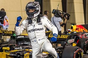 Valtteri Bottas reacts after taking pole position for the Bahrain Grand Prix.