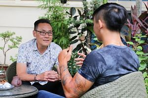 Pastor Don Wong, founder and executive director of The New Charis Mission, talking to Wilson, a resident at its halfway house, last Monday. Wilson, 19, was given 27 months' probation for drug offences.