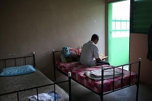 After waking up in the morning, Mr Ahmad, who is a resident at the Pertapis Halfway House, prepares himself for the day ahead. Residents at the Pertapis halfway house can read religious books available in the prayer area of the facility.
