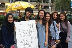 Although Ms Cassandra Thng received some hostile stares while walking around various places with her sign on March 31, the Transgender Day of Visibility, she also found support. About 65 people took photos with her, and three girls prayed that she wo