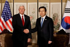 US Vice-President Mike Pence shakes hands with acting South Korean President and Prime Minister Hwang Kyo Ahn during their meeting in Seoul, on April 17, 2017.