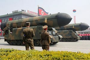Among the weapons on display at the parade in Pyongyang on Saturday was what appeared to be a new type of intercontinental ballistic missile, said military specialists. Former spy chief Kim Won Hong, said to have been sacked in January, made a surpri