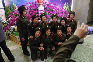 Soldiers at a flower exhibition in Pyongyang yesterday, held as part of festivities to mark the 105th birth anniversary of North Korea's founder Kim Il Sung. Pyongyang is set to celebrate another anniversary - the founding of its army on April 25 - a