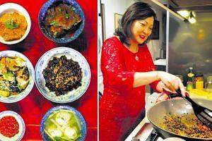 Lynnette's Kitchen's beef rendang, babi pongteh, buah keluak fried rice, bakwan kepiting (meatball soup), sambal belacan and chap chye in homemade stock.