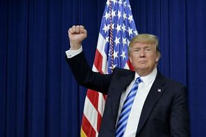 US President Donald Trump gestures during a town hall meeting with executives on the America business climate in the South Court Auditorium of the White House in Washington, DC, on April 4, 2017.