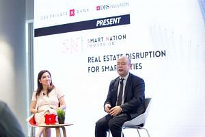 Mr Taizo Son, president and CEO of Mistletoe Inc with Ms Tan Su Shan, DBS Bank group head of consumer banking and wealth management, at DBS workshop on digital transformation on April 17, 2017.