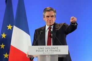 French presidential election candidate for the right-wing Les Republicains (LR) party Francois Fillon gesturing as he delivers a speech during a campaign meeting, on April 17, 2017.