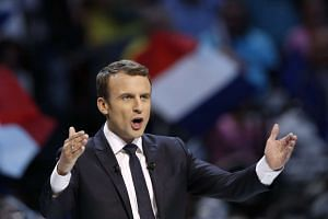 French presidential election candidate Emmanuel Macron delivers a speech during his political campaign rally at the AccorHotels Arena, in Paris, France, April 17, 2017.