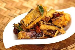 Fried brinjal with salted egg yolk.