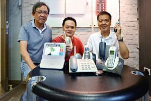 From left: Astralink executive director Fong Hean Chuan, chief technology officer Ng Chin Tiong and CEO Bill Chang with some of the firm's products past and present.