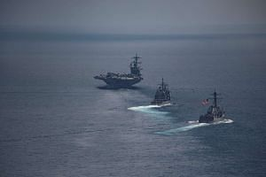 The aircraft carrier USS Carl Vinson leads the USS Michael Murphy and the USS Lake Champlain, in the Indian ocean on April 14, 2017.