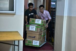 Boxes being brought out from the Hougang United Football Club office in Hougang Stadium. Bill Ng is chairman of the club and a presidential contender in the upcoming FAS election.