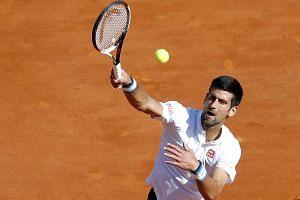 Djokovic returns the ball to David Goffin of Belgium during their Monte Carlo Masters quarter final match.