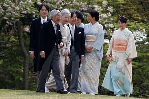 Emperor Akihito (foreground), flanked by Empress Michiko, with (from left) Prince Akishino, Crown Prince Naruhito, Princess Kiko, Crown Princess Masakoand Princess Mako at the annual spring garden party on Thursday.