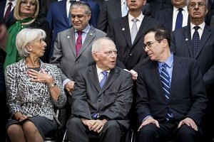 (From left) IMF chief Christine Lagarde, German finance minister Wolfgang Schaeuble and US Treasury secretary Steven Mnuchin ahead of the group photo, April 22, 2017.