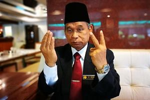 The self-styled Raja Bomoh praying for Malaysia's protection against North Korea.