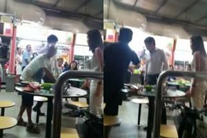 A couple shouted and pushed an elderly man who wanted to share a table at a hawker centre with them on April 21, 2017.