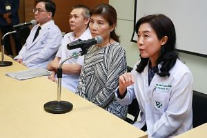 Dr Piyaphan Punyatanasakchai (right) said that her clinic had only conducted blood and sperm tests for the two foreigners linked to the smuggling case.