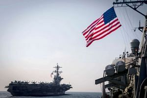 USS Carl Vinson (left) and USS Wayne E. Meyer during an exercise east of the Korean peninsula on March 22, 2017, with several other US and Republic of Korea Navy ships and submarines.