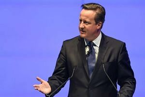 Former British prime minister David Cameron delivers the keynote address during the World Travel and Tourism Conference in Bangkok on April 26, 2017.