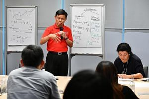 Mr Chan Chun Sing explaining to reporters at a media briefing yesterday how slower economic growth and changing patterns of employment mean the labour movement has to embrace a wider pool of workers beyond union members, to include PMEs, those in SME