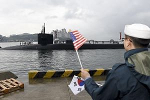 A US Defence Department handout photo showing the USS Michigan submarine arriving in Busan, South Korea, yesterday. It is set to join the USS Carl Vinson aircraft carrier in drills near the Korean peninsula.