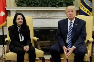 Aya Hijazi, an Egyptian-American woman detained in Egypt for nearly three years on human trafficking charges, meets with US President Donald Trump at the White House in Washington on April 21, 2017.
