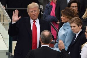 Donald Trump is sworn in as the 45th US president by Supreme Court Chief Justice John Roberts in front of the Capitol in Washington on Jan 20, 2017.