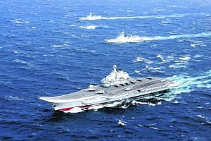 File photo of China's Liaoning aircraft carrier with an accompanying fleet conducting a drill in the South China Sea.