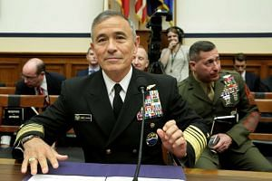 Admiral Harry Harris waits to testify before a House Armed Services Committee.