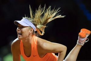 Sharapova serves to Russia's Ekaterina Makarova in their second round match.