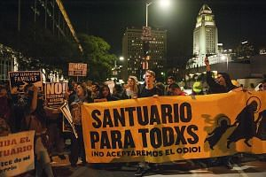 There have been protests such as the one in Los Angeles (above) in February against President Donald Trump's Jan 25 order to withhold federal funding for local governments offering safe harbour for illegal immigrants.