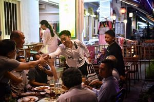 Bill Ng met affiliates at a restaurant in Bussorah Street on Thursday (April 27).
