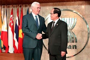 US vice-president Mike Pence (left) is greeted by Asean secretary-general Le Luong Minh at the Association of Southeast Asian Nations (Asean) Secretariat in Jakarta, on April 20, 2017.